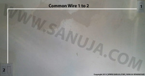 Common Wire is routed between two switches.